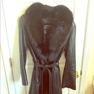 Belted black leather coat with faux-fur collar